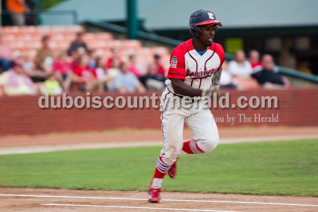 The Dubois County Bombers' Daniel Johnson sprinted to first during the second game of the league playoffs at League Stadium  on Saturday night in Huntingburg. The Hoptown Hoppers defeated the Dubois County Bombers 12-2. <br /> Alisha Jucevic/The Herald