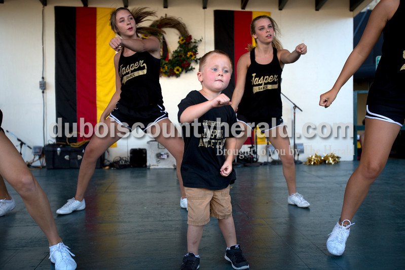 """Erica Lafser/The Herald<br /> Honorary dance team member, Braylon Beach of Jasper, 4, led the Wop dance at the street dance party Saturday night for the Strassenfest. """"He goes to every practice,"""" Beach's grandmother, Jill Wigand, said."""