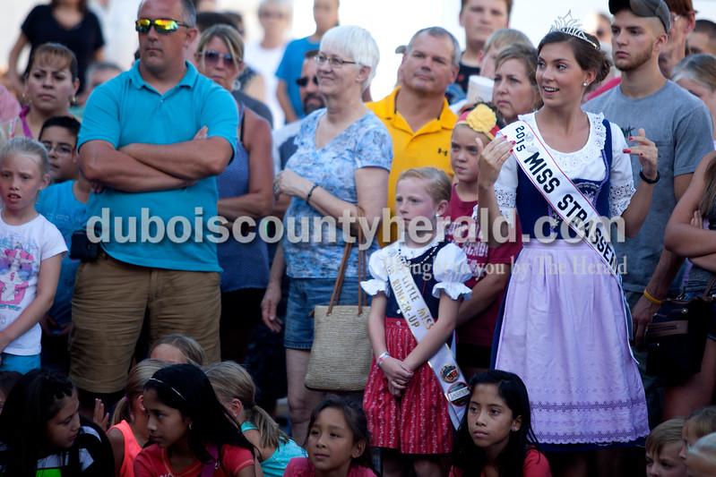 """Erica Lafser/The Herald<br /> 2015 Miss Strassenfest Camille Ruff of Jasper, 17, danced to """"Shake it Off"""" in the audience while the Jasper Elementary dance team performed during the street dance party on Saturday night for the Strassenfest."""