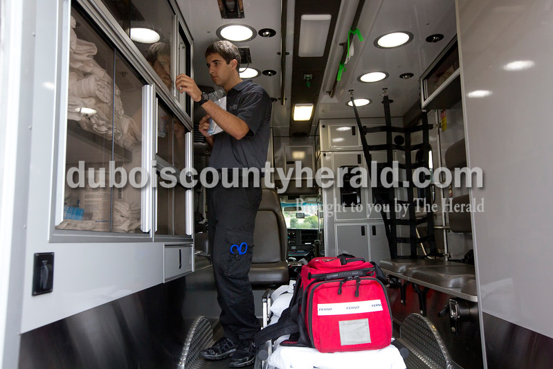 Mitch Mehringer of Jasper, 19, refilled supplies on the ambulance on which he is working as an EMT on June 29. Mehringer, who will start at Indiana University this fall as a pre-med student, first became interested in being an EMT through his HOSA class at Jasper High School. Originally we wanted to become a physical therapist, but after shadowing a doctor at Memorial Hospital as part of the class's requirements, he realized he wanted to do internal medicine. Being an EMT, he hoped, will help him be ahead in his studies.