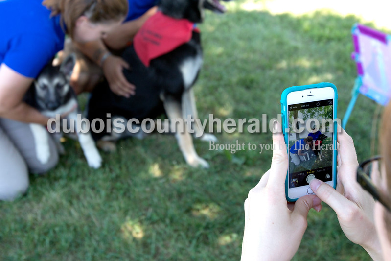 Erica Lafser/The Herald<br /> Owners of Pawzible Solutions, Ali Brewer of Jasper, left, and Tony Neal of Jasper, right, posed for a picture with their dogs Lilly and Shadow after the Dachshund Dash at Schroeder Complex on Saturday for Strassenfest. They sponsored Molly, the winner of the Dachshund Dash.