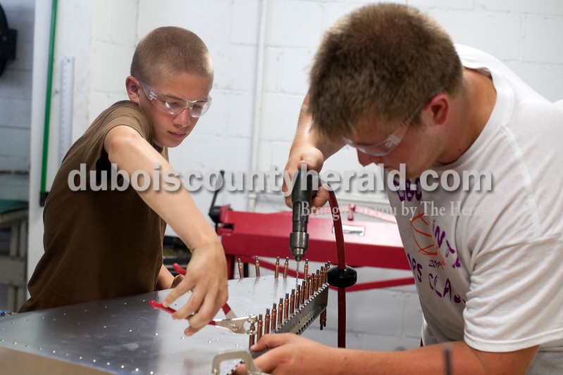 Erica Lafser/The Herald<br /> Trey Mundy of Haysville, 14, left, and Jarah Gordon of Jasper, 18, worked to assemble a portion of an aircraft at Huntingburg Airport last week. A program at the airport organized by Eric Seber of Jasper has been meeting weekly since February to construct a Sonex aircraft group members hope will eventually be complete after additional fundraising is completed to purchase the rest of the kit.