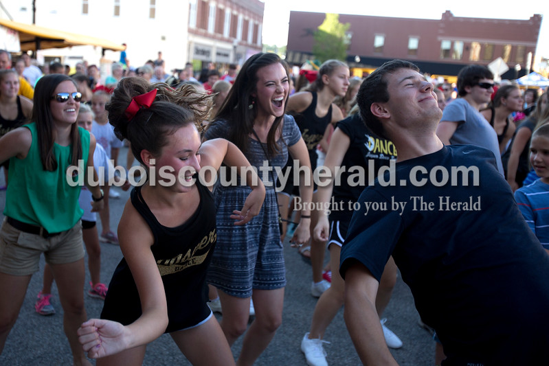 Erica Lafser/The Herald<br /> Dance team member Kylie Krempp of Jasper, 14, front left, was one of the girls leading others during the street dance party on Saturday night for the Strassenfest in Jasper. Krempp was surrounded by Brittney Hopf of Jasper, left, Kristen Krempp of Nashville, Tennessee, center right, and Dakota Begle of Ferdinand, who showed off how to Wobble.