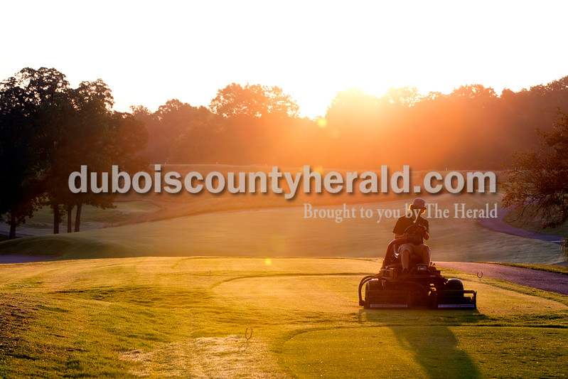 Derek Beckman of Jasper, 18, mowed tees in the early morning hours of July 24 at Sultan's Run in Jasper. Before working at Sultan's Run, Beckman said he was not a morning person, but in the four years he's worked at the golf course, he's grown to love watching the sun rise as he works on maintaining the grounds. Beckman will be a freshman at  Indiana University-Purdue University Indianapolis this year.