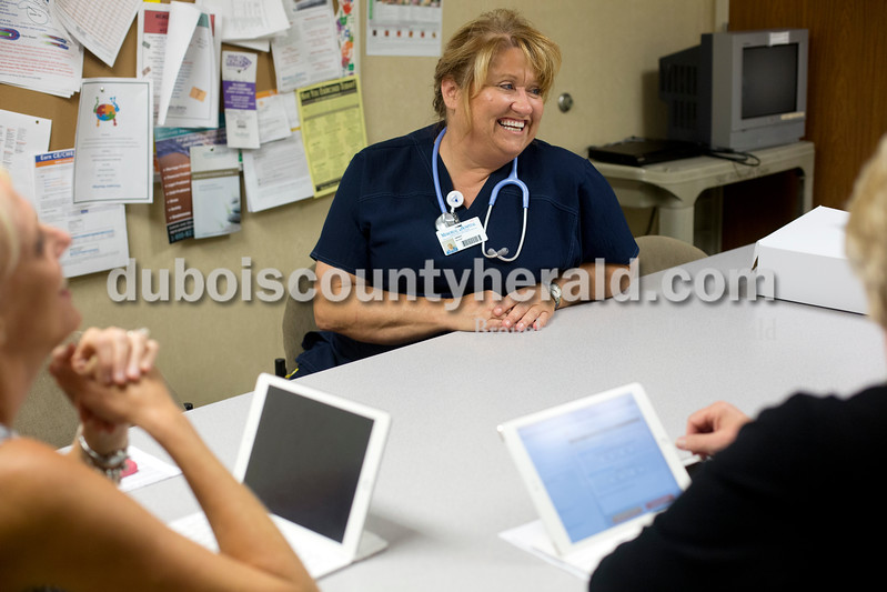 Ariana van den Akker/The Herald<br /> Janet Kemp of Huntingburg, right, participated in an administrative rounding session at Memorial Hospital in Jasper on Friday. Kemp, who just started a job as a nurse at the hospital, went from having a well-paying job to homelessness a few years ago. She recently graduated with a degree in nursing with help from the VUJC Family Scholar House, which provides financial assistance and support for single parents going back to school.