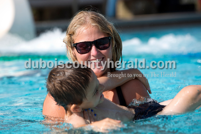 Mallory Peter of Huntingburg, 17, held Kaden Boeglin of Huntingburg, 5, while giving him swim lessons at the Huntingburg Municipal Swimming Pool on July 23. Peter, who will be a senior at Southridge, has worked at the pool for three years, first selling candy and then as a lifeguard. She especially enjoys giving kids swimming lessons and finds that the most rewarding aspect of her summer job.