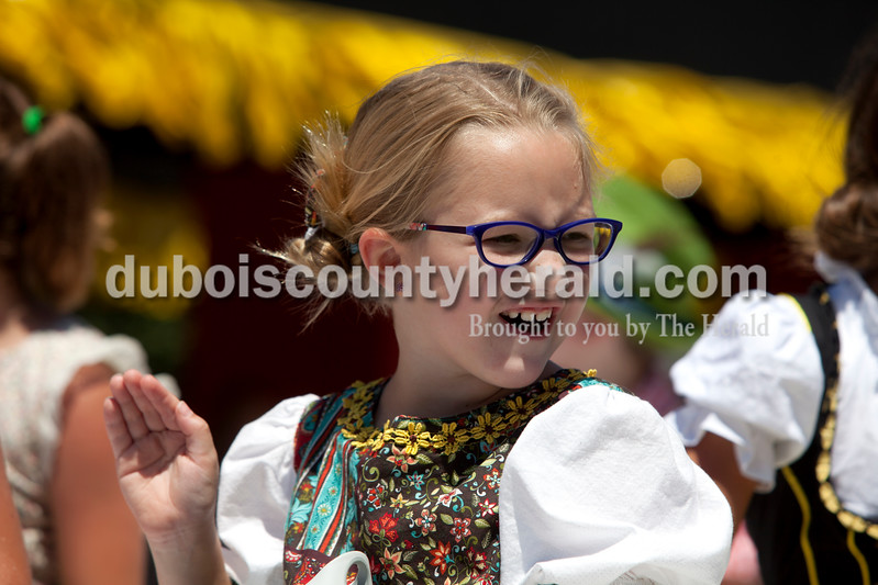"""Erica Lafser/The Herald<br /> Claire Linette of Ireland, 7, rode on the Little Mister and Misses Strassenfest float during the Strassenfest parade on Sunday in Jasper. """"Feeling the breeze is awesome,"""" Linette said."""