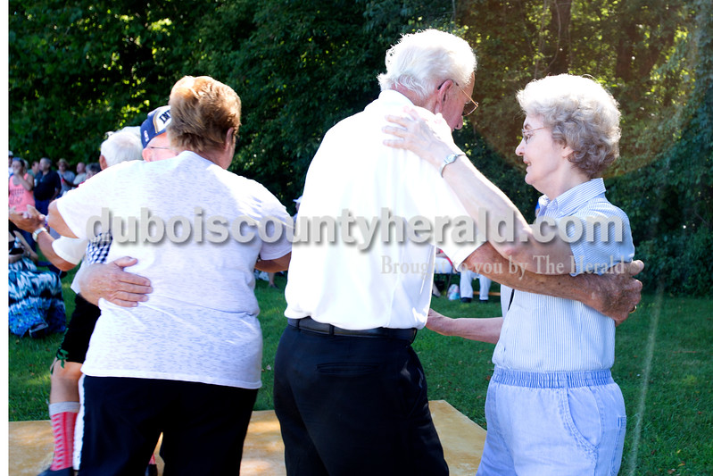 """Erica Lafser/The Herald<br /> Delores Uebelhor and Leo Eckerle, both of Jasper, danced the old time waltz to music performed by Freddie Ray J. and the Boys outside of Schaeffer Barn on Saturday morning during the Strassenfest weekend. """"We've been dancing together at VFW for several years,"""" Uebelhor said."""