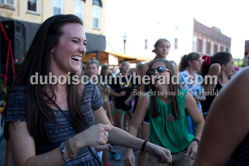 Erica Lafser/The Herald<br /> Kristen Krempp of Nashville, Tennessee, left, danced the cupid shuffle along side her sister on the dance team, Kylie of Jasper, 14, not pictured, during the street dance party Saturday night for Strassenfest.