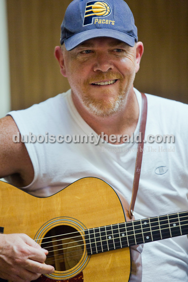 Jeff Crandall of Huntingburg traveled the world in the 1980s as guitar player in the Navy Band. His step-grandfather was a musician in the navy and inspired Crandall to follow in his footsteps. Crandall now owns Birdland Music in downtown Jasper and gives private guitar lessons to all ages.