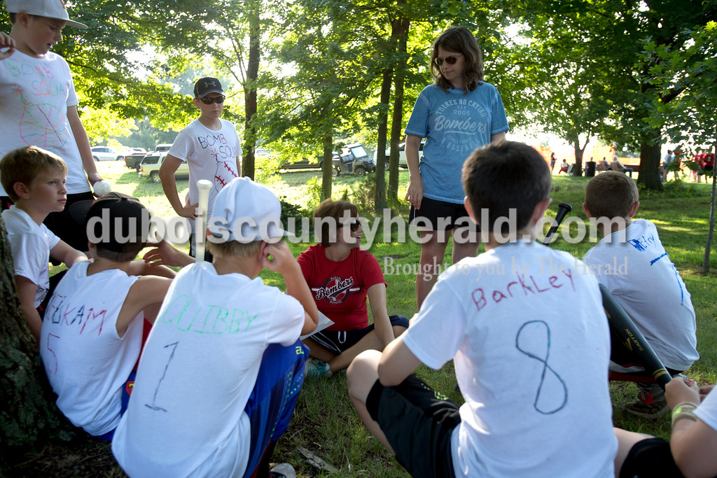 Erica Lafser/The Herald<br /> Shannon Fuhs of Huntingburg, left, coached the defending youth division whiffle ball tournament champions, Bomb Squad, with Ashley Blessinger of Huntingburg, right, before one of their games during the annual Zoar Mosquito Fest on Friday at Zoar United Methodist church and its picnic grounds in Holland. Fuhs and Blessinger are moms of some of the boys on this team and these boys are on the same summer league and All-stars teams.
