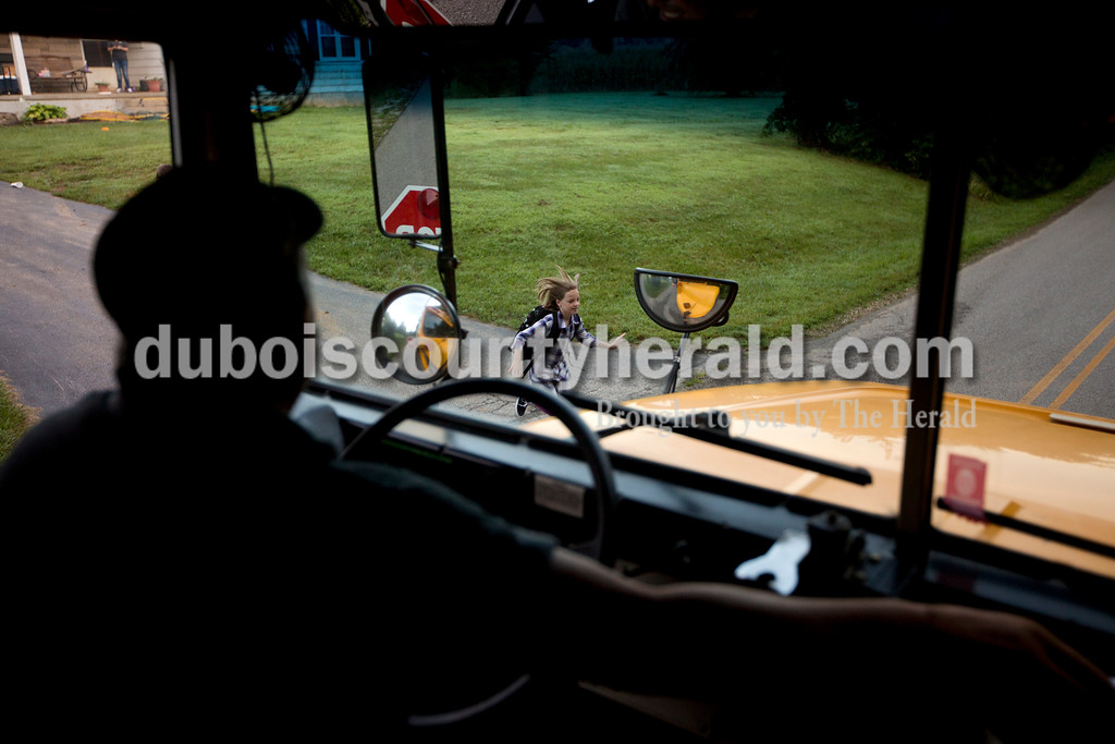 Ariana van den Akker/The Herald<br /> Dubois Elementary third-grader Ryia Linne ran to Jason Braunecker's school bus on the first day of the school year on Friday morning. Braunecker of Dubois has been driving a school bus for the Northeast Dubois School Corporation for three years.