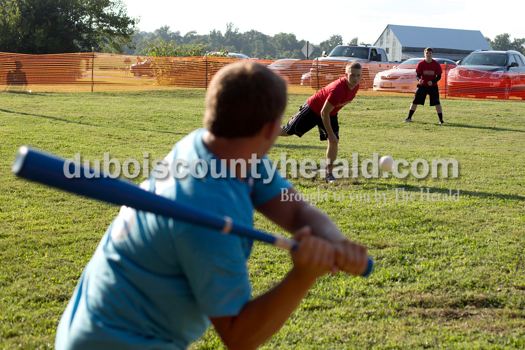Erica Lafser/The Herald<br /> Bryce Harter of Huntingburg hit a home run with this pitch thrown by Cody Greeene of Loogootee during the adult division of the whiffle ball tournament at the annual Zoar Mosquito Fest on Friday at Zoar United Methodist church and its picnic grounds in Holland.