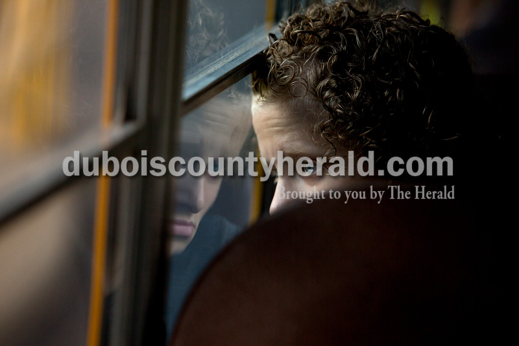 Ariana van den Akker/The Herald<br /> Dubois Middle sixth-grader Norah Klem looked out the window while riding Jason Braunecker's school bus on the first day of the school year on Friday morning.