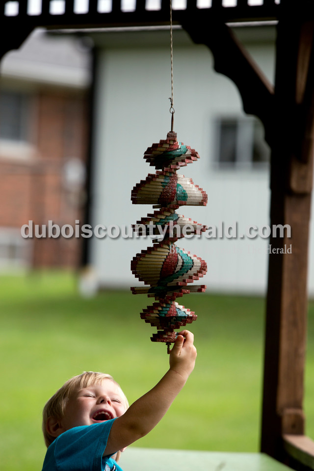 Ariana van den Akker/The Herald<br /> Bentley Mohr of Ferdinand, 3, played with a decoration at the home of his great uncle and aunt, John and Marjorie Mohr of Ferdinand, on Monday afternoon. Bentley and his brother Issac, 8, spend their days at John and his wife Marjorie's home and sometimes help out with the garden.