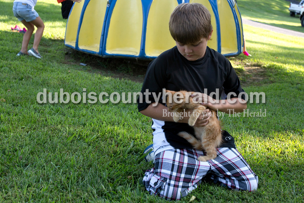 """Erica Lafser/The Herald<br /> Corey Goeppner of Velpen, 10, found """"Buddy"""" a few weeks ago and took him to the annual Zoar Mosquito Fest on Friday at Zoar United Methodist church and its picnic grounds in Holland."""