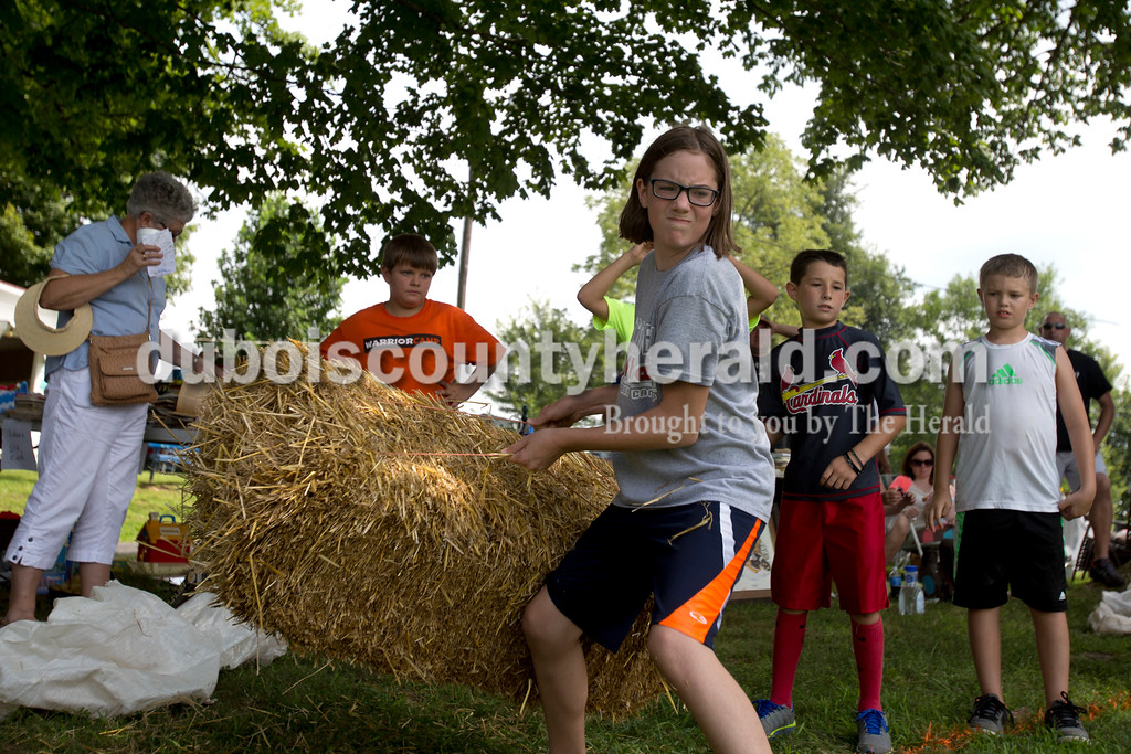 Erica Lafser/The Herald<br /> Emily Yates of Lynnville, 10, competed and finished first in the 10 and under hay bale contest that was one of the activities on Saturday for the annual Zoar Mosquito Fest at Zoar United Methodist church and its picnic grounds in Holland.