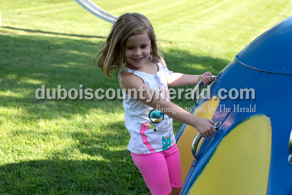 Erica Lafser/The Herald<br /> Phoebe Hollinden of St. Henry, 5, enjoyed the different activities at the annual Zoar Mosquito Fest on Friday at Zoar United Methodist church and its picnic grounds in Holland.