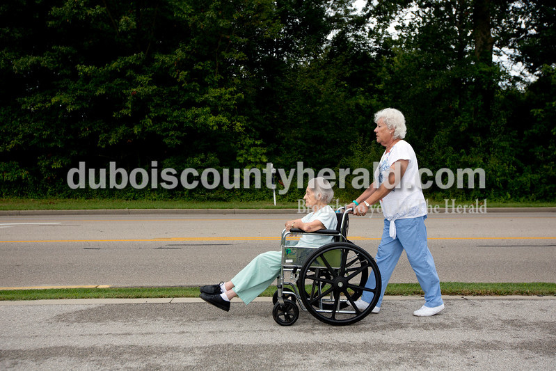 Ariana van den Akker/The Herald<br /> Volunteer Sylvia Priser of Jasper pushed St. Charles resident Ruby Thimling during the Friday fitness walk at St. Charles Health Campus in Jasper. Every Friday this summer, employees or volunteers have taken residents on a walk along the St. Charles Street walking path to the First Presbyterian Church and back.
