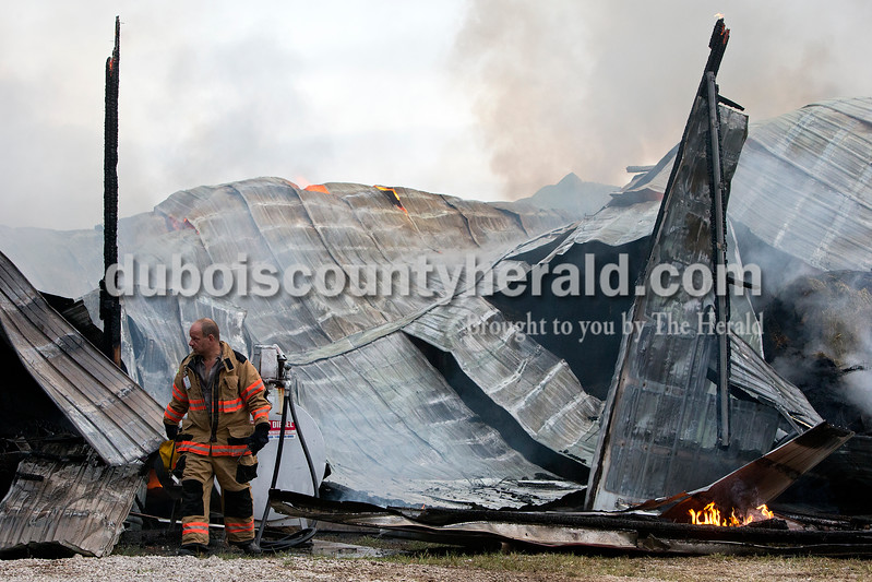 St. Anthony Volunteer firefighter David Fischer survey the damage while units worked to extinguish the fire this morning.  Dave Weatherwax/The Herald