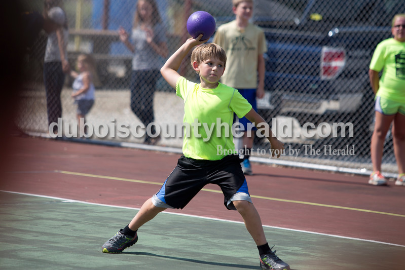 Erica Lafser/The Herald<br /> Jackson Kreilein of Huntingburg, 9, threw the dodgeball at his opponents during one of the first games in the dodgeball tournament on Saturday during the St. Anthony Firemen's Fest on the tennis courts  at the St. Anthony Community Center in St. Anthony.