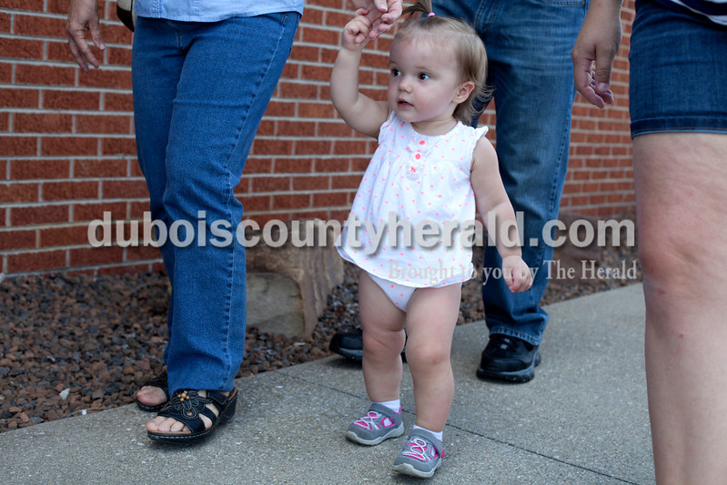 Erica Lafser/The Herald<br /> Michelle Sermersheim held her 17-month-old granddaughter Elsie Sermersheim's hand as they walked into the St. Anthony Community Center for dinner on Saturday at the St. Anthony Firemen's Fest in St. Anthony.