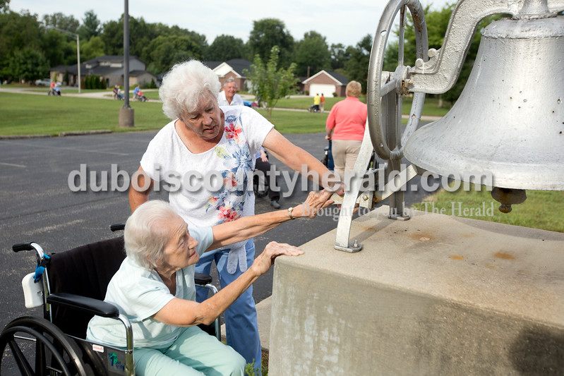 Ariana van den Akker/The Herald<br /> St. Charles resident Ruby Thimling rang a bell with help from volunteer Sylvia Priser of Jasper at the First Presbyterian Church in Jasper during the Friday fitness walk at St. Charles Health Campus in Jasper. Every Friday this summer, employees or volunteers have taken residents on a walk along the St. Charles Street walking path to the church and back.