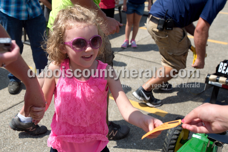 Erica Lafser/The Herald<br /> Hallie Boehm of Celestine, 5, received a prize for competing in the kiddie tractor pull during St. Anthony Firemen's Fest at the St. Anthony Community Center on Saturday in St. Anthony.