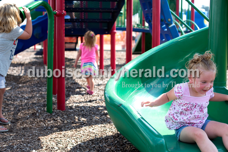 Erica Lafser/The Herald<br /> Heidi Jeffries of Celestine, 4, left, played alongside Madelyn Berg of St. Anthony, 3, middle, and Yasmyn Dalton of French Lick, 4, during the St. Anthony Firemen's Fest on Saturday at the St. Anthony Community Center in St. Anthony.