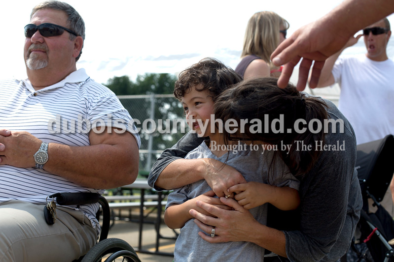 Erica Lafser/The Herald<br /> Joe Hochgesang of Jasper, left, watched the kiddie tractor pull race during the St. Anthony Firemen's Fest on Saturday at St. Anthony Community Center in St. Anthony while Audrey Lichlyter of Jasper, right, gave her son Drake, 4, center, a pep talk before his turn at the kiddie tractor pull.