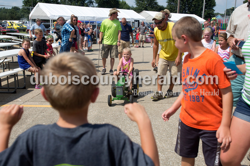 """Erica Lafser/The Herald<br /> Adison Andry of Birdseye, 5, pedaled her hardest while being cheered on by her father, Todd, during the St. Anthony Firemen's Fest on Saturday at the St. Anthony Community Center in St. Anthony. """"She told me when she woke up today, """"dad, I'm winning first place today,"""""""" Todd said."""