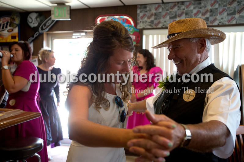 Erica Lafser/The Herald<br /> Natalie Combs of Mentor, left, danced with her father, Birnie Jeffries of St. Anthony, right, in celebration of her 15th wedding anniversary with Jeremy Combs on Saturday at Arnies Tavern in St. Anthony. The couple's friends and family members came dressed in the worst dresses they could find thrift shopping.