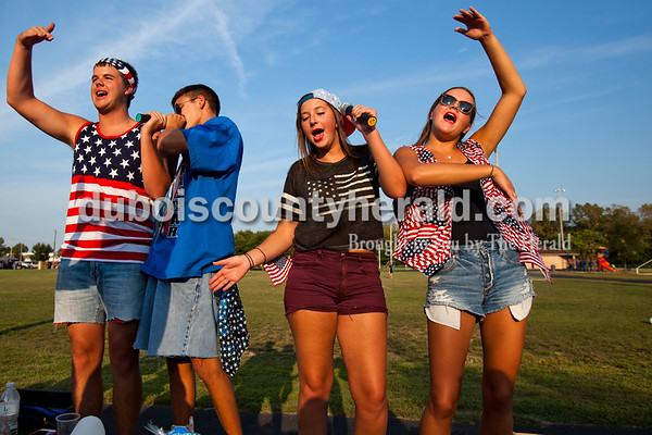 """Jasper High School seniors Aaron Persohn, Alex Korn, Jade Rohlman and Allie Wood sang along to Mylie Cyrus' """"Party in the USA"""" during Friday night's game at Jerry Brewer Alumni Stadium in Jasper. The Wildcats defeated the Raiders 18-13.  Alisha Jucevic/The Herald"""