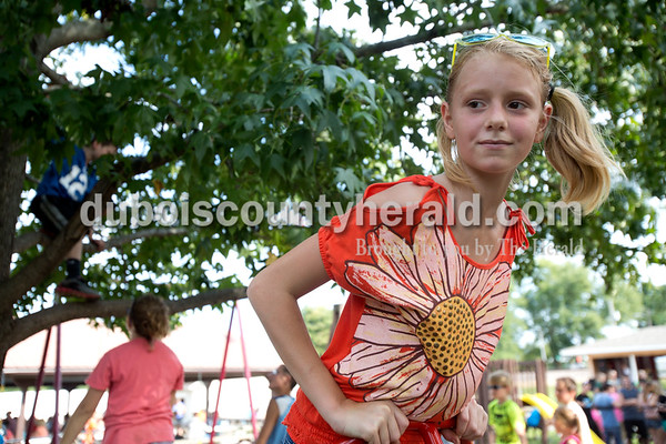 Erica Lafser/The Herald Sierra Lamb of Indianapolis, 10, played at Birdseye Park on Saturday during Birdseye Picnic with her sister Shavona, not pictured. Their grandfather, William Spencer of Indianapolis, owns a farm in Birdseye that they visit often.