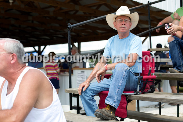 Erica Lafser/The Herald Nick Brames of Celestine watched the tractors attempt to pull weight as far as they could during the tractor pull at the Celestine Volunteer Fire Department's annual tractor pull on Sunday at the Celestine Community Club in Celestine.