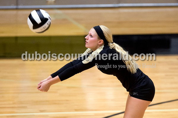 Jasper's Michala Flamion bumped the ball during Tuesday night's game against Heritage Hills in Jasper. The Wildcats won in three sets. Ariana van den Akker/The Herald