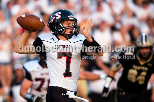 Southridge's quarterback Gaage Fetter passed the ball during Friday night's game at Jerry Brewer Alumni Stadium in Jasper. The Wildcats defeated the Raiders 18-13.  Alisha Jucevic/The Herald
