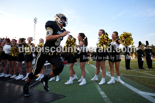 Jasper's Hunter Gossett ran out onto the field at the start of Friday night's game at Jerry Brewer Alumni Stadium in Jasper. The Wildcats defeated the Raiders 18-13.  Alisha Jucevic/The Herald