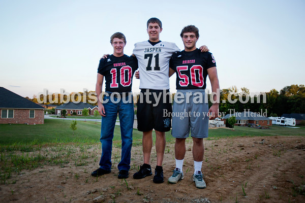 Southridge High School sophomore Kortland Hartke, Jasper High School senior Carson Englert and Southridge High School senior Mason Hartke, now living under the same roof, will face off against one another in Friday's game between Jasper and Southridge. The Hartke's mother started dating Engler's father two years ago and the families consolidated households at the beginning of August.  Alisha Jucevic/The Herald