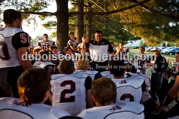 Southridge's head coach Scott Buening pumped up his team before  Friday night's game at Jerry Brewer Alumni Stadium in Jasper. The Wildcats defeated the Raiders 18-13.  Alisha Jucevic/The Herald