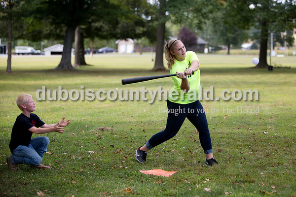 Ariana van den Akker/The Herald On Wednesday evening, members of the St. Celestine and St. Raphael junior high and high school youth groups flocked to the Dubois Community Park in Dubois for a cookout to start the new school year. Courtney Weisheit of Dubois, 13, kept her eye on the ball as Gavin Knies of Dubois, 10, played catcher while waiting for the food to be ready.