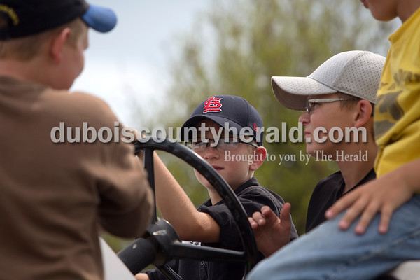 Erica Lafser/The Herald Landon Seitz of Dubois, 10, was surrounded by his friends before his turn at attempting a pull during the Celestine Volunteer Fire Department's annual tractor pull on Sunday at the Celestine Community Club in Celestine. Seitz faced the challenge of nerves that came with being one of the youngest to participate in the big tractor pull.