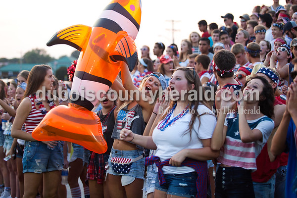 """Jasper High School senior Ally Metzger held a blow up fish floatie during Friday night's game at Jerry Brewer Alumni Stadium in Jasper. """"It's kind of our mascot,"""" she said. The Wildcats defeated the Raiders 18-13.  Alisha Jucevic/The Herald"""