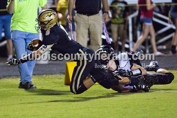 Jasper's Hunter Gossett was tackled by Southridge's Mitchell Mundy as he made it into the end zone for Jasper's second touchdown of Friday night's game at Jerry Brewer Alumni Stadium in Jasper. The Wildcats defeated the Raiders 18-13.  Alisha Jucevic/The Herald
