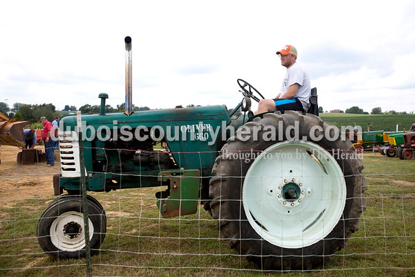 Erica Lafser/The Herald Jordan Lammers of Duff waited for his turn to pull during the tractor pull at the Celestine Volunteer Fire Department's annual tractor pull on Sunday at the Celestine Community Club in Celestine. Lammers has participated for over 10 years.
