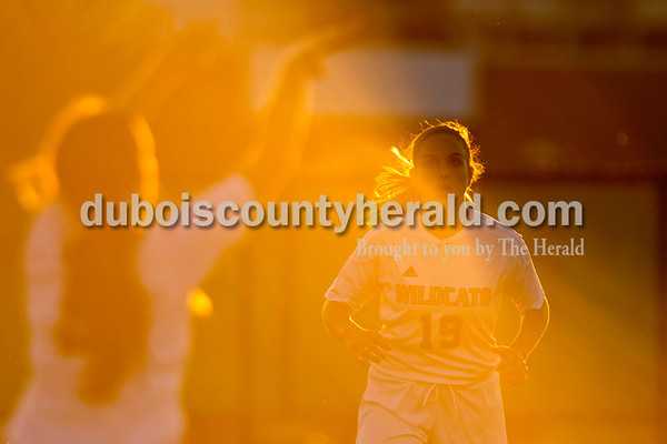 Erica Lafser/The Herald Jasper's Hannah Love watched her teammate throw the ball from the sidelines during Wednesday night's game against Evansville Harrison in Jasper, in preparation to gain possession. The Wildcats won 8-1.