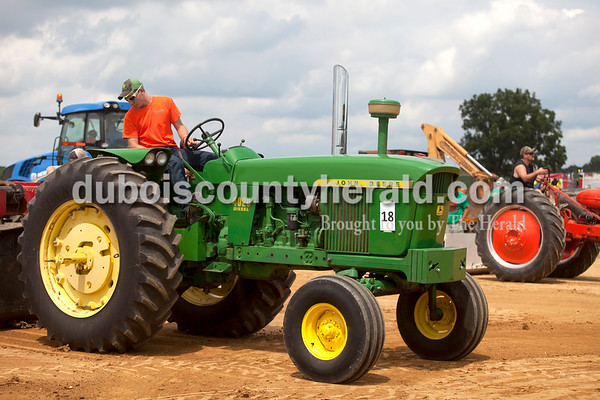 Erica Lafser/The Herald Curtis Gress of Celestine, 16, waited for the weight to be attached to his tractor so he could attempt a pull at the Celestine Volunteer Fire Department's annual tractor pull on Sunday at the Celestine Community Club in Celestine.