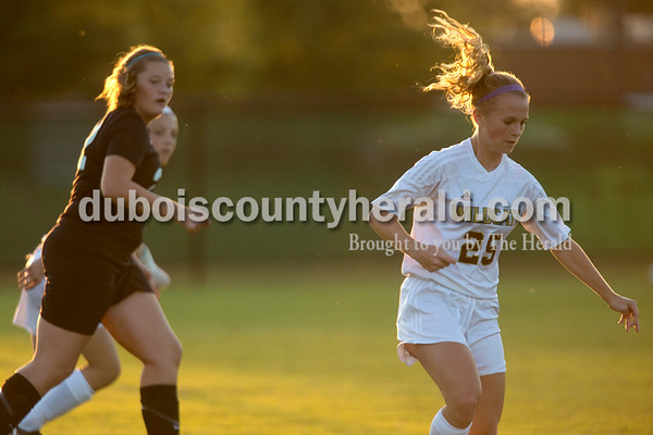 Erica Lafser/The Herald Jasper's Madisyn Hunt chased the ball to keep possession during Wednesday night's game against Evansville Harrison in Jasper. The Wildcats won 8-1.