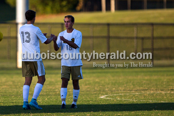 Jasper's Jace Englert fist bumped Noah Farmer after Farmer made the fist goal of Monday night's game against Boonville in Jasper. The Wildcats won 4-0. Alisha Jucevic/The Herald