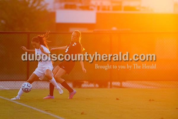 Erica Lafser/The Herald Jasper's Chloe Smith managed to not touch the ball before it went out of bounds, so her team could keep possession during Wednesday night's game against Evansville Harrison in Jasper. Smith was followed by her opponent, Claire Dugan. The Wildcats won 8-1.